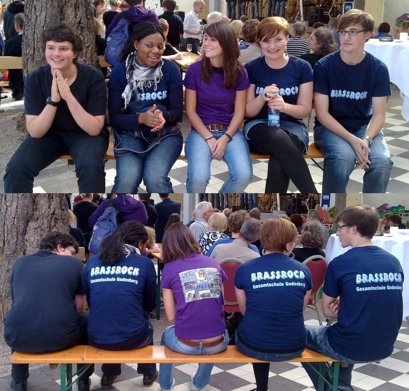 Unsere Absolventen kriegen immer ein Band-T-Shirt - in dem in Lila steckt Julia.